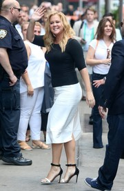 Amy Schumer sheathed her curves in a tight black top for her appearance on 'Good Morning America.'