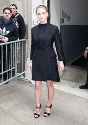 Alice Eve complemented her coat with black satin ankle-strap sandals.