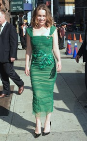 Emilia Clarke looked downright fab in a green leaf-print corset dress by Dolce & Gabbana as she arrived for her 'Stephen Colbert' appearance.