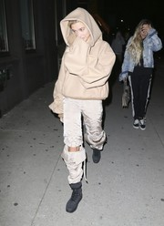 Hailey Baldwin bundled up in an oversized beige hoodie by Johanna Ortiz for Travis Scott's birthday party.