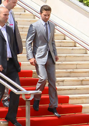 Shia LaBeouf was a knockout in his iridescent silver suit at the 'Wall Street 2' photocall in Cannes.