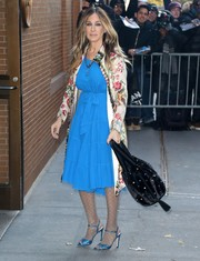Sarah Jessica Parker matched her frock with blue glitter sandals from her own line.