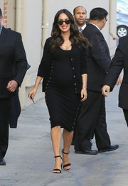 Megan Fox finished off her maternity dress with a black cardigan.