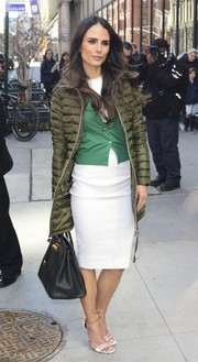 Underneath her coat, Jordana Brewster was demure in a green cardigan and a little white dress.