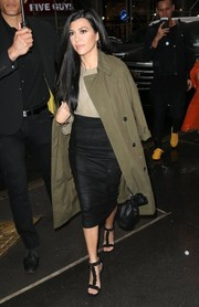 Kourtney Kardashian accessorized with a black leather drawstring pouch by Alexander Wang.