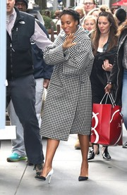 Kerry Washington bundled up in a classic black-and-white houndstooth coat as she left the NBC Studios.