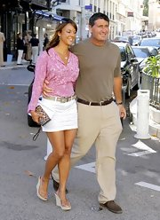 Eva la Rue sported a sweet-meets-sexy look with this long-sleeve blouse and mini skirt combo during a trip to Monaco.
