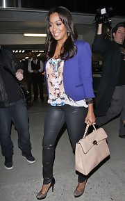 La La Vazquez hit the town carrying a ladylike cream leather Rock Stud Top Handle bag.