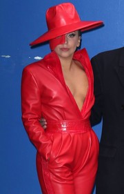 Lady Gaga visited 'Good Morning America' rocking an all-red leather hat, mask, and jumpsuit combo.