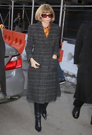 Anna Wintour showed her classic style with a gray tweed coat while attending New York Fashion week.