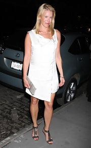 Chelsea showed off her toned gams in a white frock.