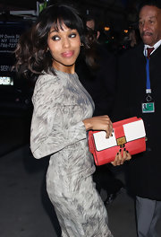 Kerry Washington's coral clutch added a nice pop of color to her outfit.