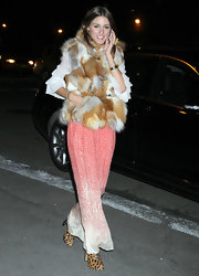 Olivia dons an eclectic ensemble with a fur vest and a peach polka-dot maxi dress.
