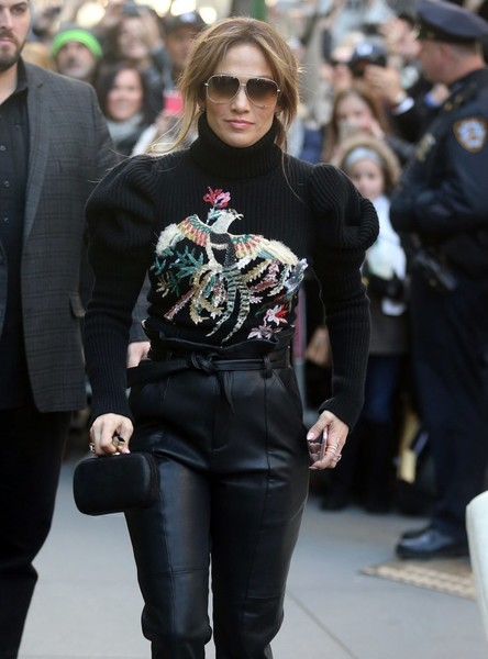 Jennifer Lopez left the 'Today Show' carrying a black leather clutch to match her sweater and leather pants.