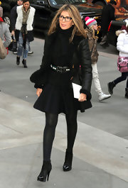 Nina Garcia's black flare mini skirt was a feminine complement to her leather jacket.