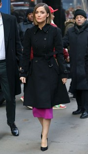 Rose Byrne covered up in a black trench coat for an appearance on Good Morning America.