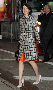 Michelle Dockery wowed in a floral coat by Erdem layered over a bright orange skirt during her visit to 'Good Morning America.'