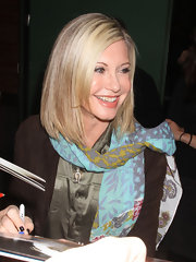 Olivia Newton-John wore her layered locks down for a TV appearance.