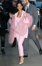 Rihanna arrived for her 'Good Morning America' appearance looking oh-so-sugary in a pink Pascal Millet pantsuit.