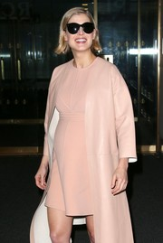 Wearing oversized cateye sunnies, Rosamund Pike was all smiles for photographers outside the NBC Studios.