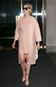 Rosamund Pike chose a pair of nude ankle-strap pumps to complete her ensemble.