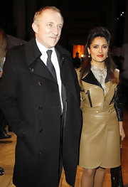 Salma Hayek sizzled at the Yves Saint Laurent show in a tan leather coat with biker detailing.