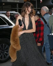 Alexa Chung was spotted outside her New York City hotel sporting a glamorous fur stole and halter dress combo.