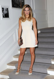Bar accessorized her fit-and-flare dress with platform pumps complete with gold detailing.