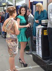 Danielle Lloyd chose black leather slingback platforms to pair with her short patterned dress when watching the races at Aintree.