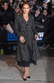 Jennifer Lopez added a bit of shine to her monochrome outfit with a metallic silver clutch.
