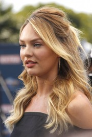 Candice Swanepoel channeled Brigitte Bardot with this sexy half-up hairstyle during her appearance on 'Extra.'