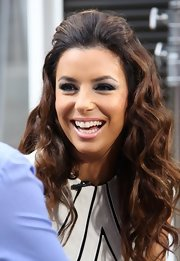 Eva Longoria chose a half up, half down 'do and fun beachy waves for her look while at 'Extra.'