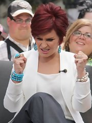 Sharon Osbourned dropped by 'Extra' wearing multiple beaded jewelry including a turquoise ring.