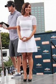 Cheryl Burke visited 'Extra' wearing an oh-so-cute LWD with mesh accents on the yoke, waist, and hem.