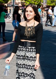 Carly Rose Sonenclar chose a black crop-top and a printed maxi skirt for her appearance on 'Extra.'