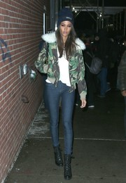 Joan Smalls left the La Perla fashion show rocking a camo bomber jacket with a fur collar.