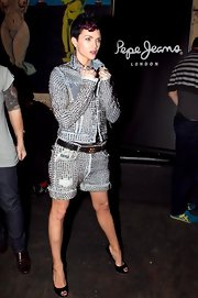 Ruby Rose perfectly paired studded cuffed shorts with a matching jean jacket. She topped off her look with peep toe pumps.