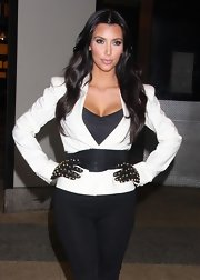 Kim's gold, spikey studded, black leather gloves are fashion forward and fierce. This is a hot way to mix it up with a conservative white blazer.