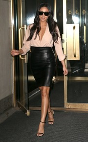 Shay Mitchell kept the allure coming with a hip-hugging, high-waisted leather skirt by ThePerfext.