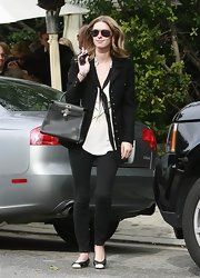 "Nicky looked chic and sophisticated in a black blazer and skinny jeans while carrying the mini black leather ""Birkin"" tote bag."