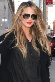 Chrissy Teigen accessorized with classic aviator sunglasses while visiting 'Watch What Happens Live.'