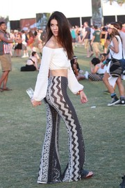 Kendall Jenner went for a fun '70s vibe with a pair of printed bell-bottoms by Novella Royale.