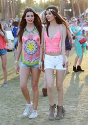 Victoria Justice flaunted some cleavage and abs in a low-cut pink crochet crop-top during Coachella.