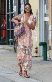 Chanel Iman chose a striped, tasseled shoulder bag for her arm candy.