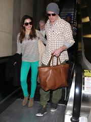Jenna Dewan-Tatum added pop to her travel gear with a pair of bright turquoise skinny jeans.