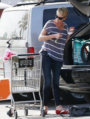 Charlize looked casual and comfy with this gray and white striped sweater.