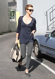 Charlize Theron rocked leggings as pants while running errands.