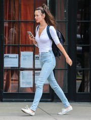 Charlotte Le Bon teamed her top with a pair of light wash jeans.
