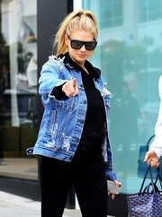 Charlotte McKinney looked edgy-chic in her shield sunglasses and distressed denim jacket while out and about in Beverly Hills.