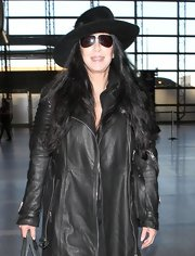 Cher exuded an air of mystery in her sunnies and hat during a flight out of LAX.